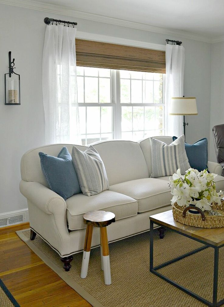 How to easily customize a living room by making DIY custom curtain rods using black pipe and fittings.
