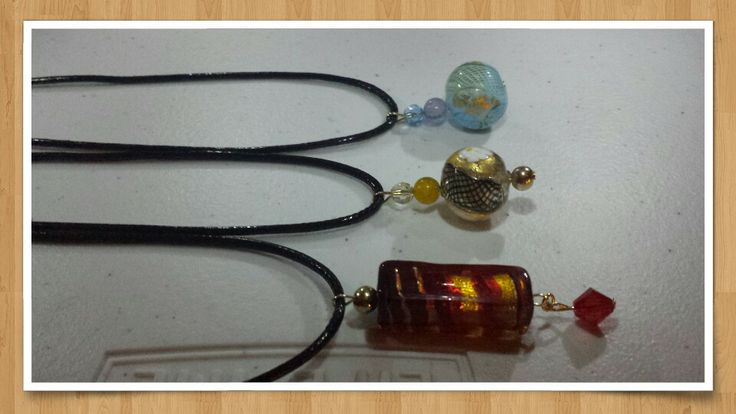 Murano pendants on leather cords created by me.