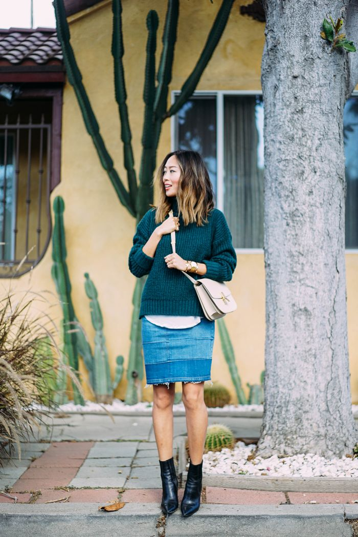 Who said denim patchwork couldn't be a trend? Aimee Song wears a faded denim tye-dye style patch skirt with a cute green knitted turtleneck and black ankle boots. Coat: Zara, Sweater: Glamorous Green, Skirt: Cheap Monday, Boots: Spiga, Bag: Celine, Bracelet: Tiffany, Watch: Larsson and Jennings.