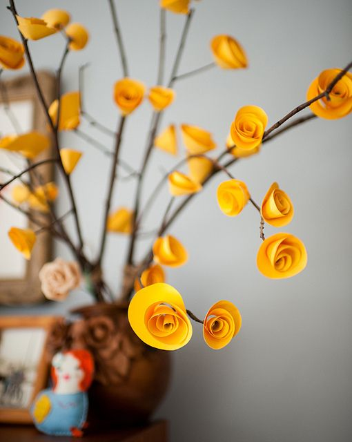 "I really really want to figure out how to make these paper flowers... then we can make center pieces, and wreaths, and long branches to put in those styrofoam balls and but them in pots to make ""trees""..."