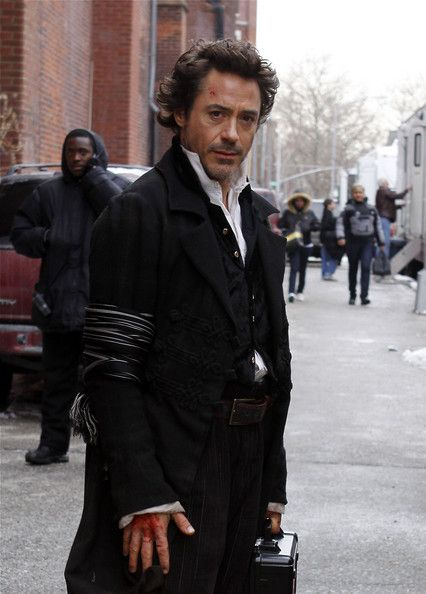 Robert Downey Jr. as Sherlock Holmes, and that would be an Iron Man lunchbox he's holding.
