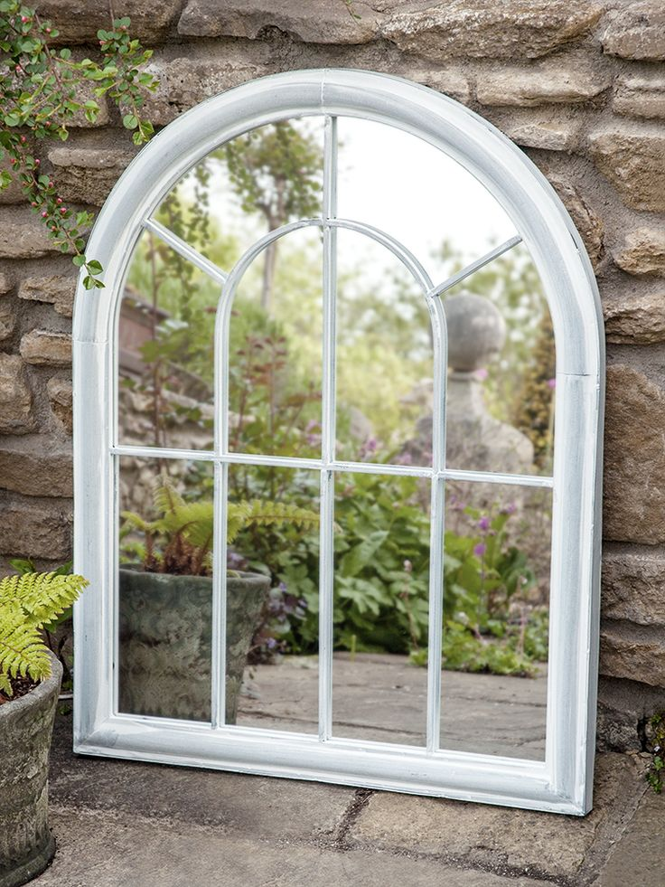 Introduce romance to your outdoor space with our arched window mirror. With its soft arched top and distressed soft grey finish, this rustic mirror adds new dimension to your garden. Made from mild steel to protect against the weather, our small arched window mirror can be propped against your garden wall to bring new life into even the smallest of spaces- why not team with our Large Outdoor Arched Window Mirror for extra- effects?