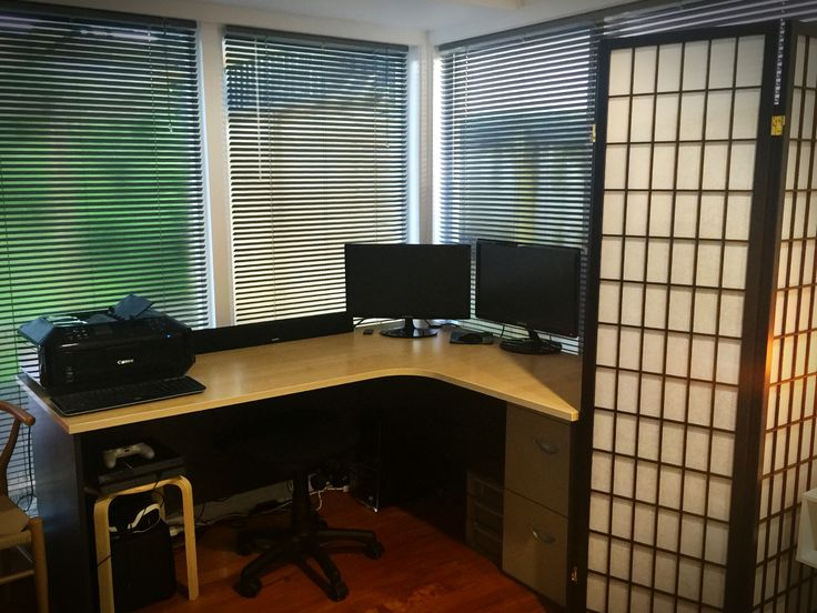 Corner desk for our office area. Shelf for paper work is hidden behind the screen and the screen folds out so to hide the desk while we're in bed