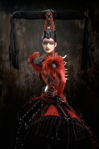 I just saw this and I thought it looked really cool. I feel like this costume would fit really well for Lucifer if we decide its going to be a girl. I like the colors and the make up.