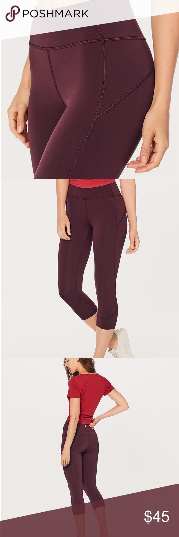 NWT 🍋 LuluLemon 🍋 In Movement Crop in Garnet ❤️ Meet your new studio workout companion: a sleek crop that fits like a second skin. Stretchy fabric wicks sweat in a flash and dries quickly, so you can go straight from Pilates to indoor cycling. Everlux fabric is four-way stretch, sweat-wicking, feels cool to the touch, and dries so fast it's like magic. Added Lycra fiber for stretch and shape retention. Hidden waistband pocket to stash your phone. High rise, hugged sensation.   BRAND NEW…