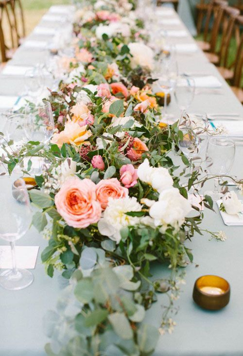 head table garland. foliage with heavy floral detailing.