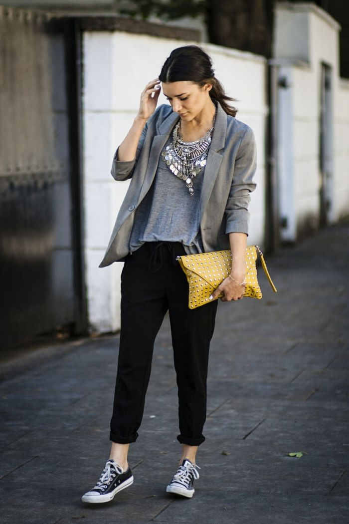 Business Casual Attire For Women Black Ankle Length Sports Pants Grey Top And Blazer Plain Sneakers Yellow Clutch Worn By Woman With Dark Hair