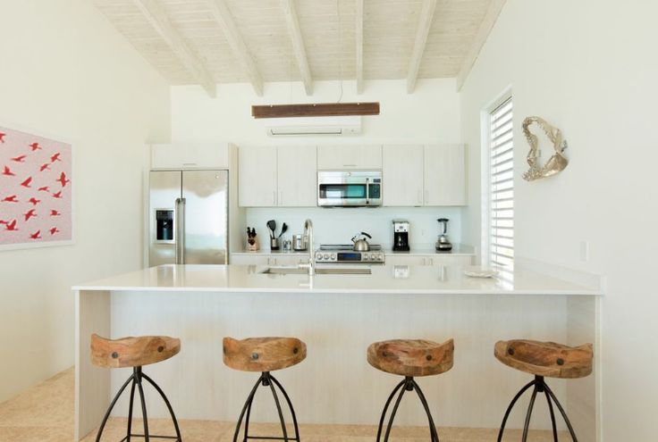 This kitchen provides a bright and open atmosphere where you can enjoy meals in your very own #Sailrock villa http://www.sailrocksouthcaicos.com/real-estate/villas