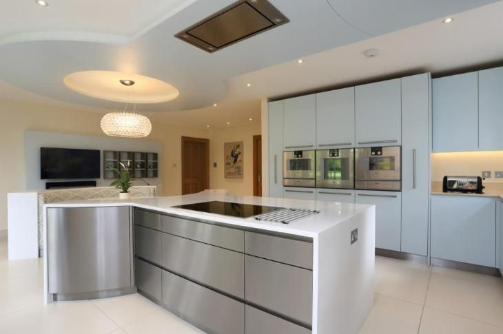 Contemporary House in Hertfordshire by John Ladbury and Company with Foscarini Caboche