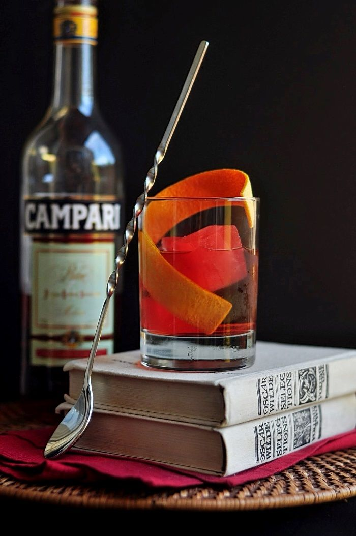 Negronez Cocktail--as Campari ice cubes melt, a Martinez is transformed into a Negroni | 2 oz gin,1 oz sweet vermouth, 1/2 oz maraschino liqueur, orange bitters, Campari ice cubes, orange peel, for garnish. To make the drink, place a few Campari ice cubes in a double rocks glass. In a cocktail shaker filled with regular ice, combine the gin, vermouth, Maraschino, and bitters. Stir until thoroughly chilled, then strain into the rocks glass and garnish with orange peel.