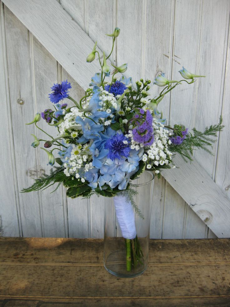 this bridesmaids bouquet in all shades of blue includes