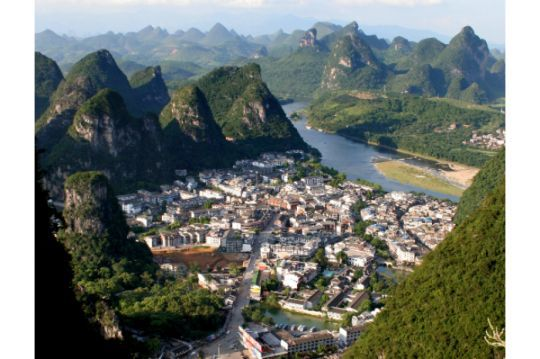 Yangshuo County, China A small county located in China's Guangxi region, Gibson said it's surrounded by beautiful mountains and breathtaking views. You can enjoy ancient temples and lots of hiking in Yangshuo. Also be sure to check out the mud caves for a day and be sure to get a selfie in one of the huge lily pad fields.