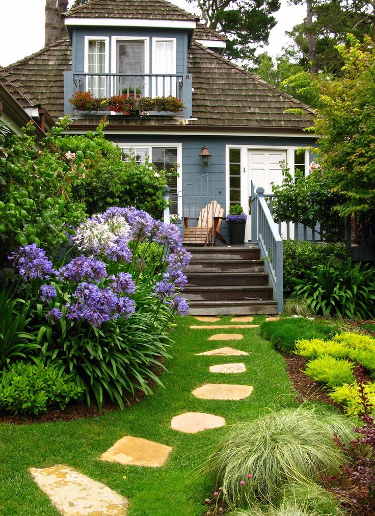 Beautiful blue cottage add curb appeal with a lovely