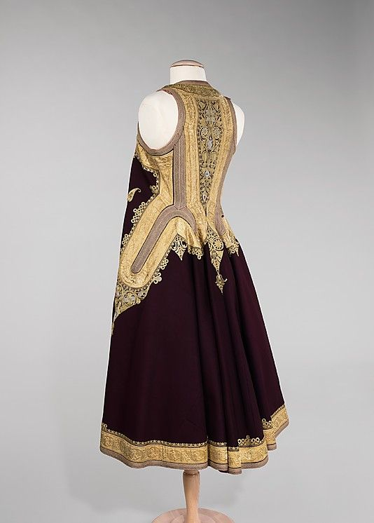 Coat. 19th century, Albania. This stunning full-length, sleeveless coat was fashioned from wool, silk, metal and cotton. The intricate designs indicate heavily to the heavy Ottoman influence in the region at the time.