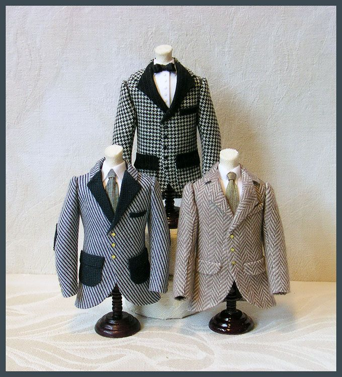 Three gentlemen's suit jackets on display stands. Adapted from original patterns