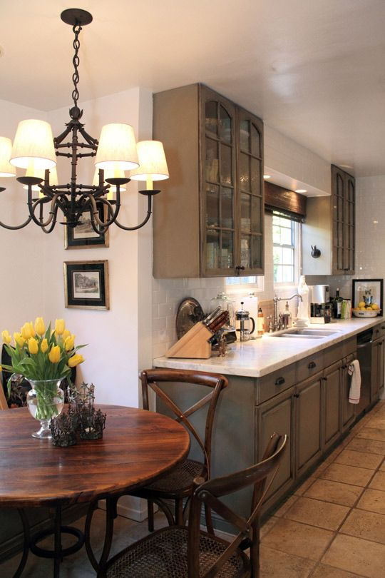 This greyish brown tone would look nice with wood trim. But with marble backsplash and white solid surface counters.