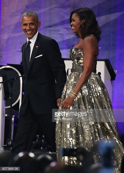President Barack Obama and First Lady Michelle Obama arrive to address the…