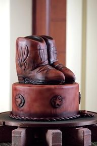 Guinness Spice Cake with Cream Cheese Frosting is the foundation for this personality-inspired groom's cake by The Ritz-Carlton, Dallas, featuring a hand-carved Rice Krispies® boot topper that's air-brushed to rugged perfection.