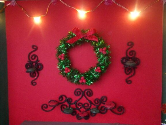 Miniature candle sconces with wreath