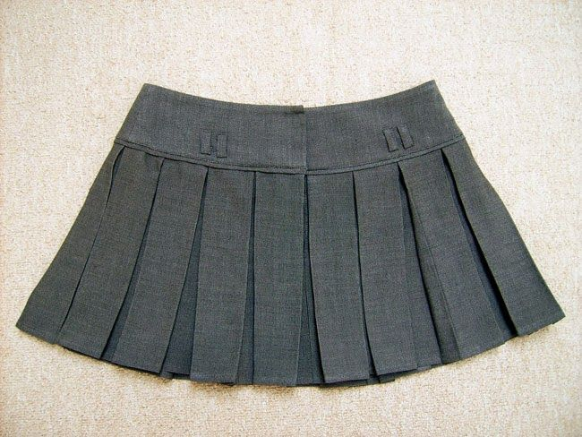 From pants to pleated skirt. My first serious attempt to the sewing machine...