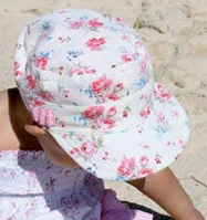 Baby Vintage Mao! The is very stylish mao hat is 100% cotton, soft and easily folded to take anywhere. It has a gorgeous floral print all over and pink with white polka dot lining. It has an elasticised band to ensures comfort & fit.