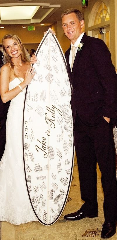 an autographed surfboard as a sign-in | Kelly and Jake | Bridal and Wedding Planning Resource for California Weddings | California Bride Magazine