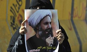 A Yemeni woman holds a poster of the Saudi Shia cleric Sheikh Nimr al-Nimr