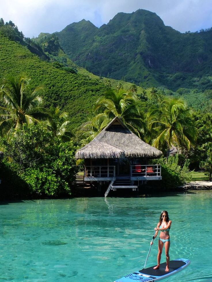 French Polynesia. I'd love to paddle board in clear and shallow waters like this.