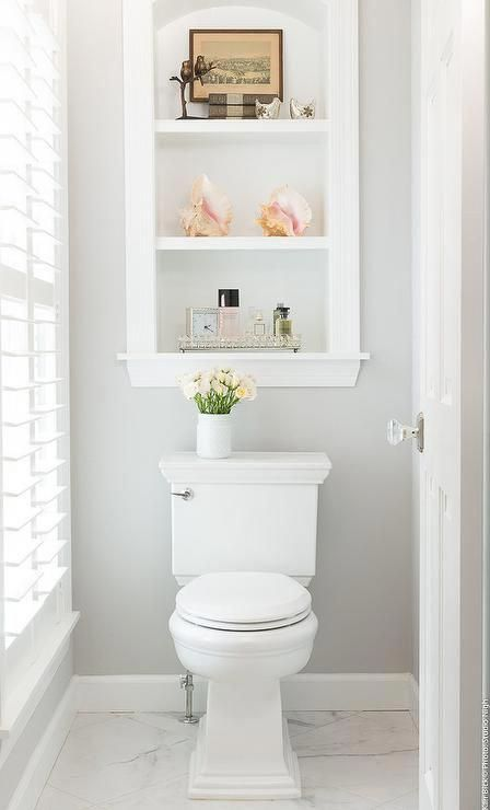 Custom inset shelves over a toilet in a transitional white and gray bathroom. #b…   – Bathrooms