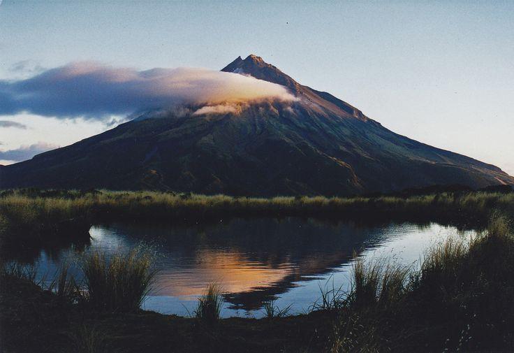 Sunset Mt Taranaki (by nigelt46)  Mount Taranaki, or Mount Egmont, is an active but quiescent stratovolcano in the Taranaki region on the west coast of New Zealand's North Island.