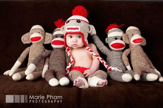 I had to pin it even though not for Olivia. If I had a boy this would have made me want to make sock monkeys his first birthday theme just so I could do this picture. So cute!