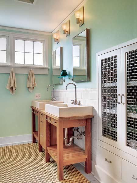 Seafoam green takes this bathroom from plain to period perfect. | Photo: Frank L. Jenkins/Vista Estate Imaging