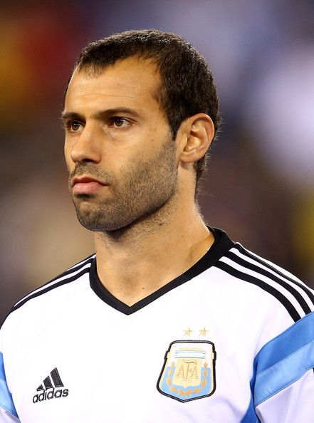 Javier Mascherano Photos Photos - Javier Mascherano #14 of Argentina looks on during player introductions before the game against Ecuador during a friendly match at MetLife Stadium on November 15, 2013 in East Rutherford, New Jersey. - Ecuador v Argentina