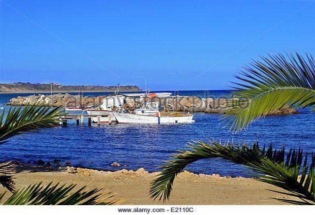 Greek Fishing Boats, Katelios Beach on the Greek Island of Kefalonia,Greece - Stock Image
