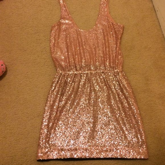 Alice and Olivia sequins dress Pink sequins dress. Mini dress. Tank on top. Black lining on skirt. Perfect for New Years! Alice + Olivia Dresses Mini