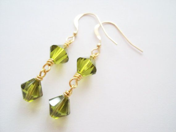Swarovski Olive green dangly earrings in gold plated brass