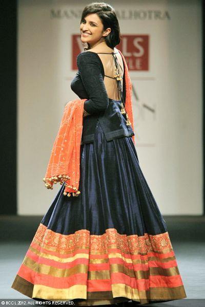 Parineeti Chopra displays a creation by designer Manish Malhotra on Day 2 of Wills Lifestyle India Fashion Week in New Delhi on October 07, 2012.