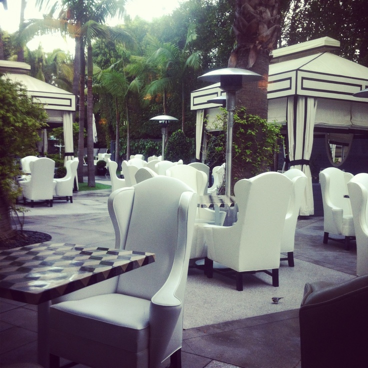 Indoor-Style High-Backed Chairs on an Outdoor Patio at Viceroy Santa Monica #design