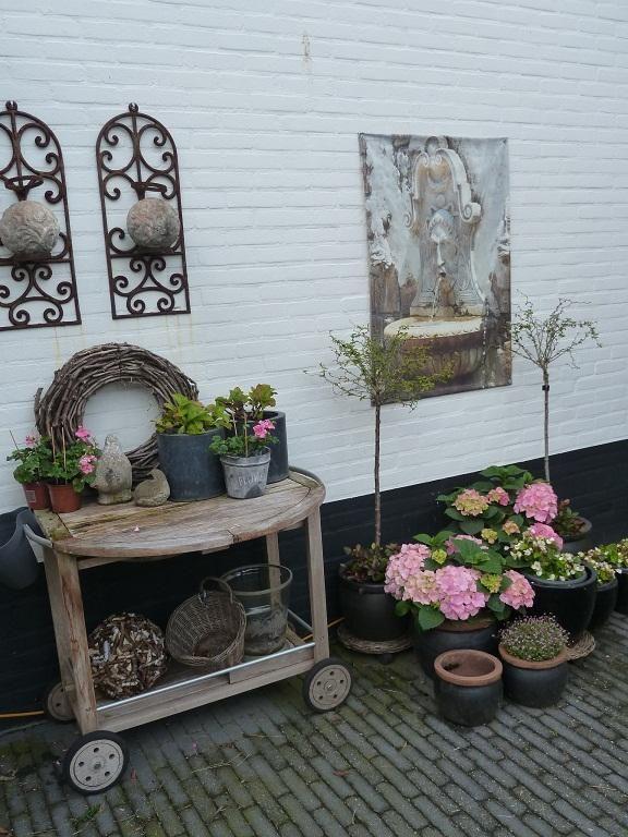Wooden garden cart, pots, garden art