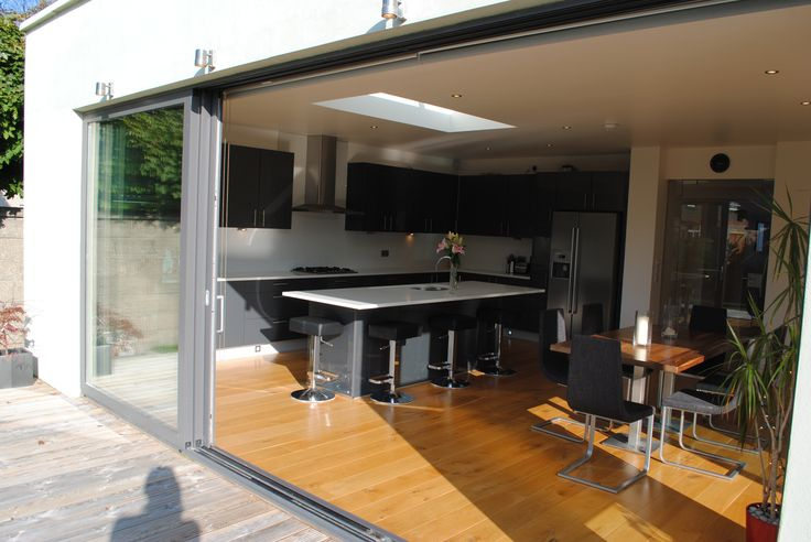 This project involved a two storey extension to the side and a single storey extension to the rear of an existing 1930′s house to create a family home suitable for today's living standards. The single storey extension to the rear houses a new open plan kitchen, living and dining area with a large internal sliding door which closes off the living area. Light wells overhead provide natural light deep into the existing house plan. Sliding aluminium framed doors lead to the garden. www.dmvf.ie.
