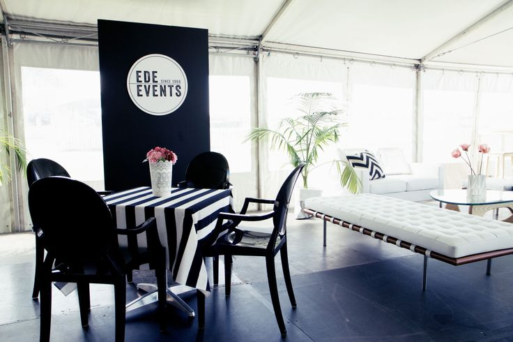 Marquee styled with black Louis Ghost chairs, tables and white Barcelona bench. http://www.edeevents.com.au/marquees