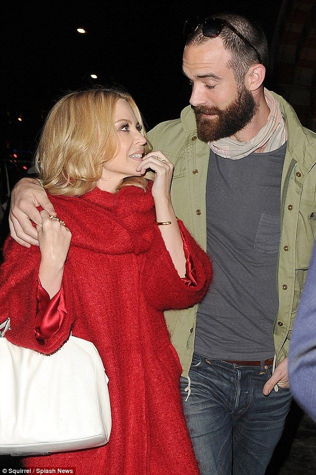 Look of love: Kylie gazes adoringly at Joshua Sasse in London this week