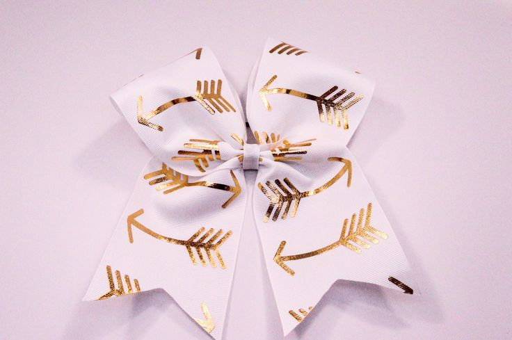 White and Gold Foiled Arrows Cheer Bow -Gold foiled arrows on Grosgrain Ribbon…