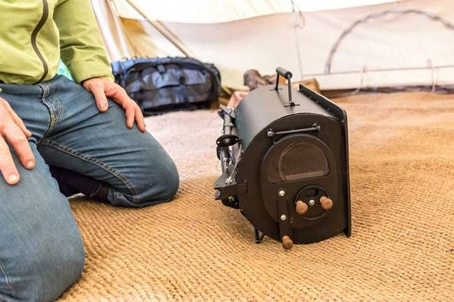 Portable woodstove folds down, heats up tents, yurts & tiny homes ...