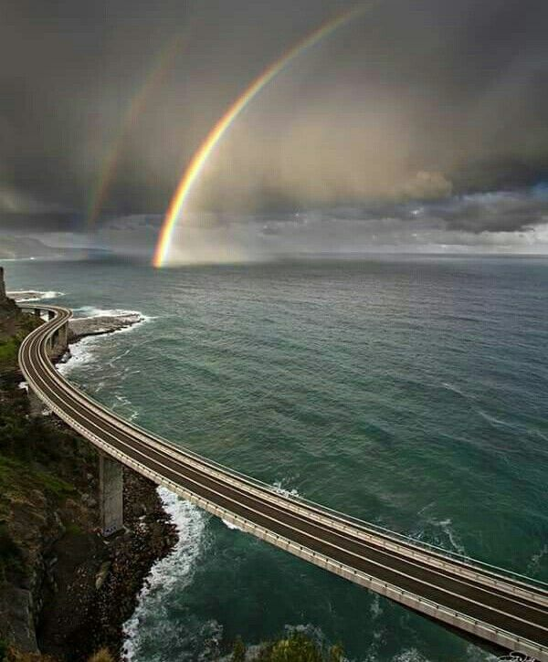 A Rainbow Dipping into Ocean