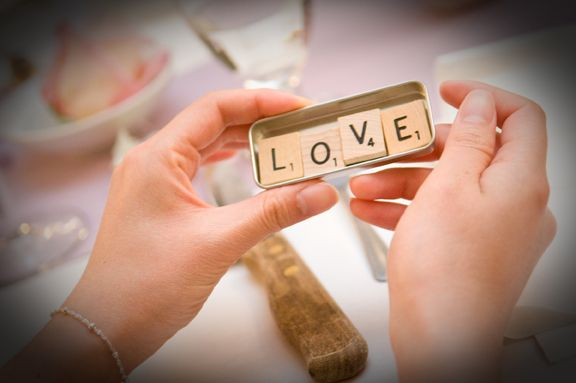Love love looove this idea for wedding favours - scrabble magnets spelling out different 4-letter words related to love!