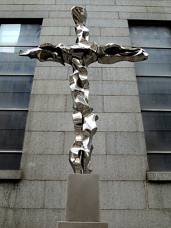 The 28-foot-high steel 9/11 Memorial Cross outside St. Peter's Roman Catholic Church, 22 Barclay Street, one block northeast of the World Trade Center, in New York City. Created by sculptor Jon Krawczyk of Malibu, California, the cross incorporates steel fragments from the fallen World Trade Center.