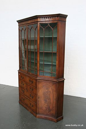 A mahogany and burr amboyna elevated secrétaire bookcase.