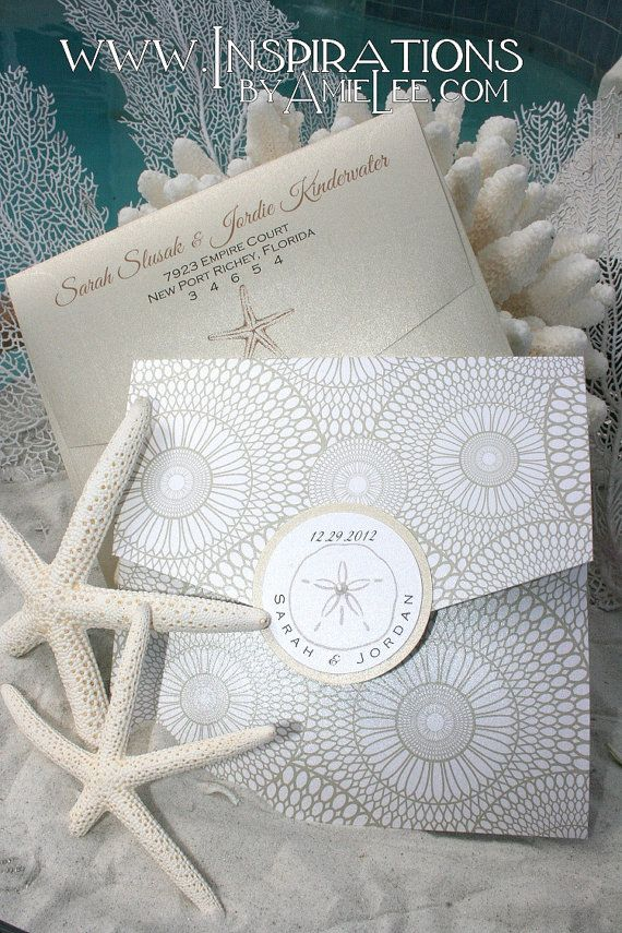 This elegant, yet fun sea shell wedding invitation features a beautiful kaleidoscope patterned paper. The base color of the paper is white