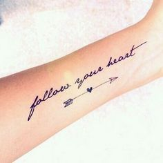 Tattoo writings: Follow Your Heart plus arrow